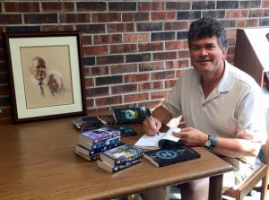 Edward Willett donating books to Butler Library